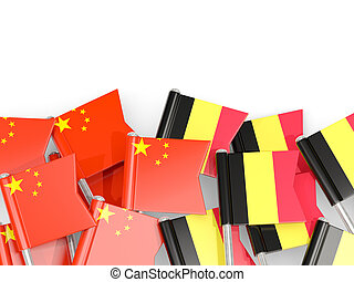 Pins with flags of China and belgium isolated on white.