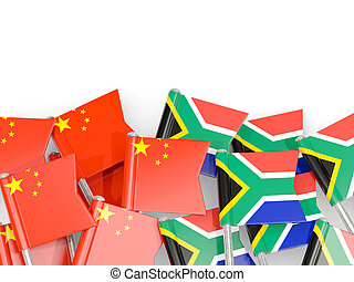 Pins with flags of China and south africa isolated on white.
