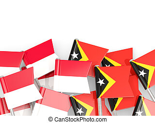 Pins with flags of Indonesia and east timor isolated on white.