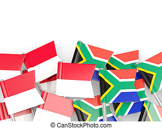 Pins with flags of Indonesia and south africa isolated on white.