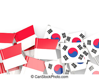 Pins with flags of Indonesia and south korea isolated on white.