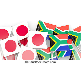 Pins with flags of Japan and south africa isolated on white.
