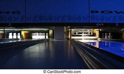Pinsetters work in dark empty bowling club, time lapse