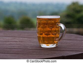 pint of beer in beer garden - traditional pint of bitter...