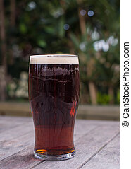 pint of bitter on pub garden table - pint of english bitter ...