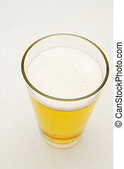 Pint of lager beer, on light background