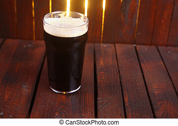 Pint of stout - A pint glass full of dark stout ale standing...