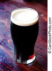 Pint of Stout - Chilled Pint of Stout in a pub setting.