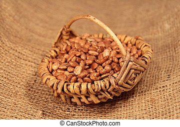 pinto beans in a basket