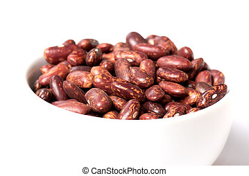 Pinto beans in a white cup close-up