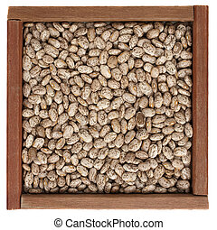 pinto beans in a wooden box