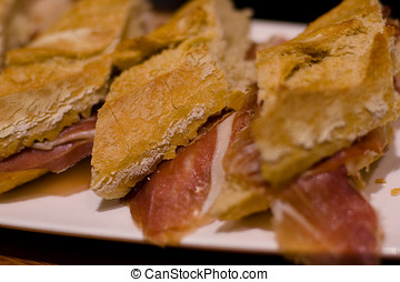 Pintxo or Tapa de Jamon Serrano or Spanish Iberico cured ham