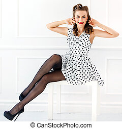 Pinup. Girl in cute dress - Pinup. Beautiful woman with wide...