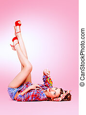 pinup lady - Sexy pin-up girl in shorts and high heels lying...