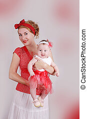 Pinup mother and baby girl standing - Happy pinup mother and...