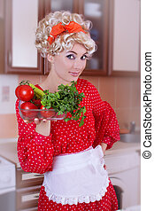 Pinup woman in red with fresh vegetables
