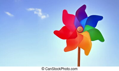 Pinwheel against the sky - Colorful pinwheel toy against...