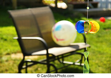 Pinwheel and loveseat in the backyard