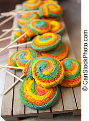 Pinwheels Lollypop for Carnival. Colored shortbread cakes.