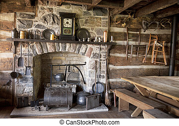 Pioneer Living Room - The fireplace and utensils of an old ...