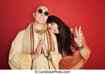 Pious guru prays with woman makes peace symbol