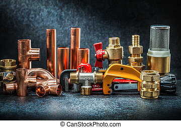 pipe cutter and adjustable wrench with brass copper connectors big set on dark background