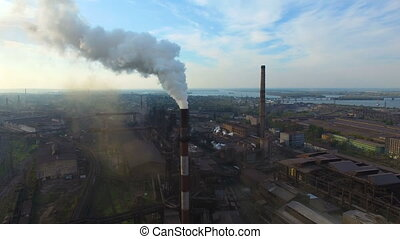 Pipe factory smoke. Aerial survey - Flying over the smoking...
