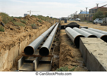 Pipe in the trench. - Laying of new pipes in Aktau,...