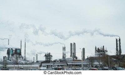 Pipe of a large plant smoke a white smoke