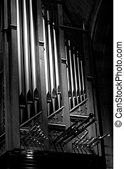 Strong contrast in this black and white photograph of pipe organ pipes. A stunning presentation of verticle and diagnal form with a hint of horizonal. All in fine art black and white photography.