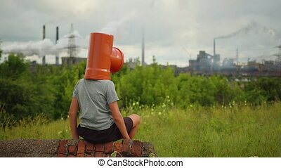 Environmental pollution, ecological disaster, nuclear war, post apocalypse concept. Care for future generations. Child in protective mask, face-guard to prevent breathing toxic air