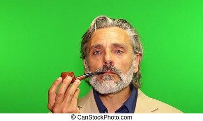 Portrait of al Mature Man smoking a pipe