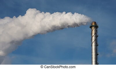 Pipe throws grey smoke in blue sky. Air Pollution Concept -...