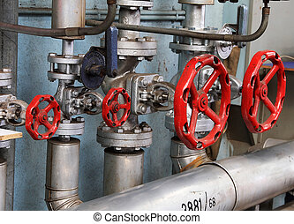 pipe valve connection - Pipes and red valves of the heating...