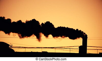Pipe with a smoke at sunrise