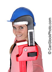Pipe wrench jaw framing a woman's face
