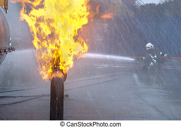Pipeline fire with firefighters - Firefighters in protective...