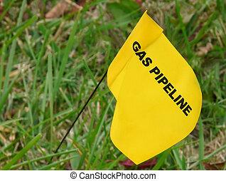 Pipeline Marker - Yellow flag marking underground natural...