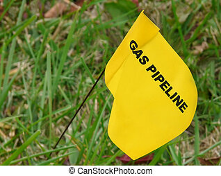 Pipeline Marker - Yellow flag marking underground natural...