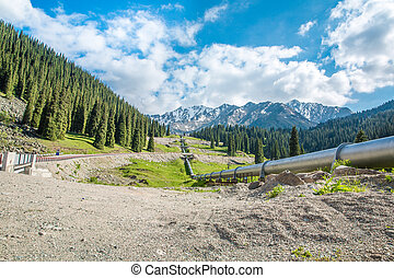 Pipeline on road Big Almaty Lake, Tien Shan Mountains in ...