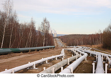 Pipelines leading into the horizon with power-station