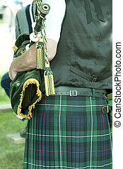 piper - Piper wearing a kilt and holding green bagpipes