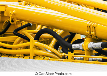 pipes and the hydraulic system of the tractor