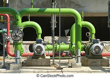 Pipes at cooling tower - Pumps, valves and green steel pipes...