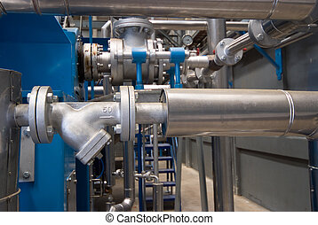 Pipes at processing plant - Pipes, valves and tanks at...