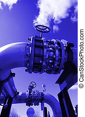 Pipes, bolts, valves against blue sky in blue tone