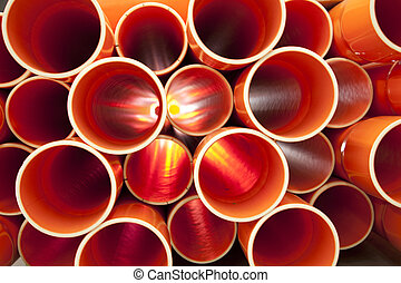 Brown PVC pipes stacked in construction site