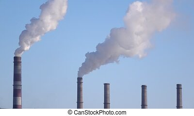 Pipes of industrial enterprise spew tons of gas into...