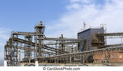 Pipes oil refining factory against a blue sky