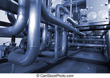 Pipes, tubes, machinery and steam turbine at a power plant in blue tone